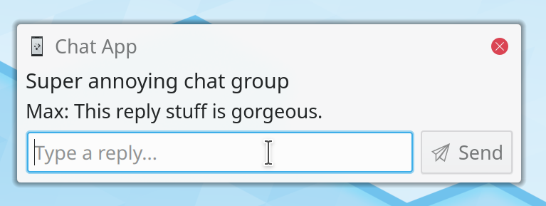 "Notification popup with a message from a chat group with text field in the notification popup inviting to ""Type a reply..."""