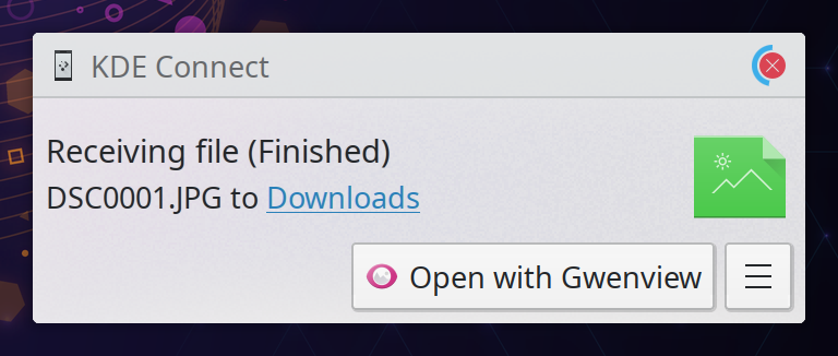 "Plasma notification popup from ""KDE Connect"", title ""Receiving file (Finished)"". Emphasis on the fact that there is now a ""Open with Gwenview"" button whereas previously it would just say ""Open"""