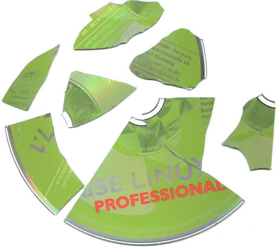 Pieces of a shattered green SuSE Linux 7.1 Professional CD